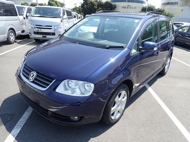 VOLKSWAGEN Golf Touran.
